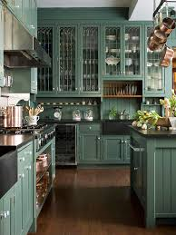 country green kitchen cabinets hunter green cabinets country kitchen bhg