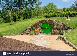 hobbit hole hobbit hole with round door and chimney pot stock photo 71326588