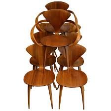 set of eight norman cherner for plycraft walnut and beech dining