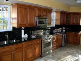 Golden Oak Kitchen Cabinets With Black Countertops  Granite - Hardwood kitchen cabinets