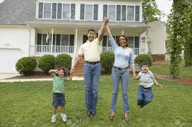 In Front Yard - family jumping together in front yard stock photo picture and