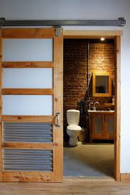 bathroom door ideas bathrooms industrial bathroom with brick wall and wood cabinet