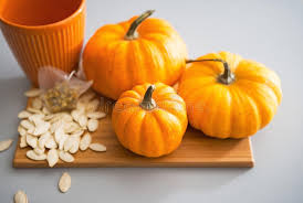 Small Pumpkins Closeup On Small Pumpkins And Seeds On Table Stock Photo Image