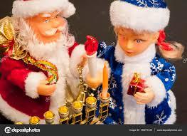 hanukkah toys toys ded moroz santa claus and snegurochka lighting hanukkah