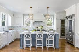 white kitchen cabinets with blue island light blue kitchen island with white cabinets iowa remodels