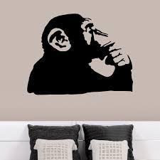 banksy monkey thinking wall decals banksy thinking monkey wall decals behind chairs