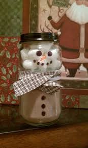 snowman made from a baby food jar the top jar is filled with