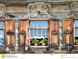 windows on the facade of the wooden house stock photo image