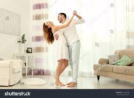 cute young couple dancing home stock photo 573523546 shutterstock