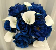 white and blue roses blue calla wedding bouquet in bloom