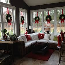 love decorations for the home love the wreaths suspended with red ribbon in the windows of this