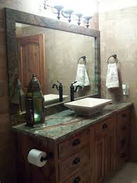 bathroom design with rain forest green granite countertops and