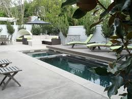 Pool Designs And Prices by Photos Hgtv Contemporary Pool And Elevated Spa With Waterfalls