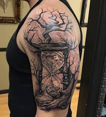 scary hourglass with tree on half sleeve