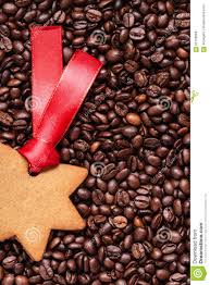 star shaped christmas cookies on coffee beans stock photo image