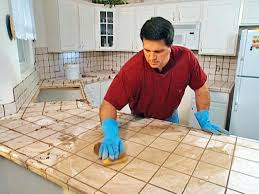 install tile over laminate countertop and backsplash how tos diy push grout tiles with circular motion