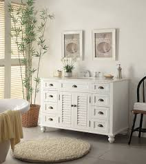 How To Decorate Your Bathroom by White Woodenvanity Having Many Wooden Drawer And Marble Top And