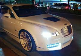 rick ross bentley wraith white bentley continental gt with custom rims upholstery body