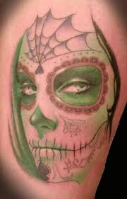 marvelous skull face tattoo made by colorful ink