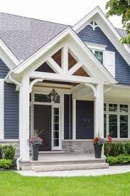 blue house white trim nice roof lines with covered front porch nice greyish blue house