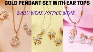 set of gold light weight gold pendant sets with ear tops daily wear office