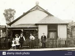 family of five in front of victorian bungalow stock photo royalty
