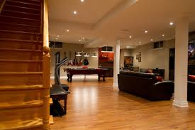 fascinating laminated wood flooring in basement area feat comfy