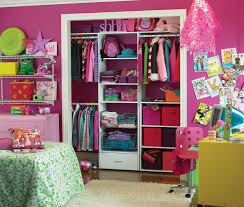 bedroom closet organization with pink walls and clothes racks
