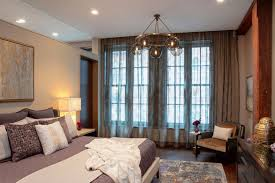 chandelier bedroom modern bedroom chandelier creates relaxed vibe in new york residence