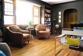 black charcoal walls natural wood trim and wood floors grey