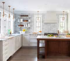 wooden canisters kitchen dc metro 4x12 subway tile kitchen transitional with brass hardware