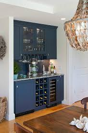 Bar Kitchen Cabinets by A Shingled House With Aqua Shutters On Cape Cod Locking Liquor