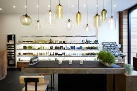 minimalist copper pendant lights over kitchen table feat island