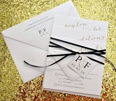 wedding invitations with ribbon astoria wedding invitation suite with ribbon tie and monogram tag