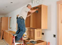 how to hang a cabinet to the wall how to install wall cabinets without studs upgraded home