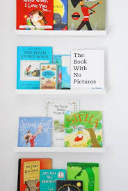 using ikea picture ledges as bookshelves in a nursery the