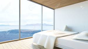 modern minimal bedroom with white bed armchair and ocean view