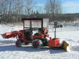 atv snowplow on back of bx tractor