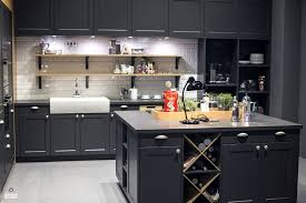 kitchen kitchen in gray with wine storage space and white tiled