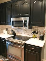 white kitchen cabinets with cathedral doors where should i put my microwave tucker