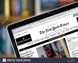 Science The New York Times Reading The Online Edition Of The New York Times On A 13