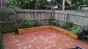 brick patio and cedar planters