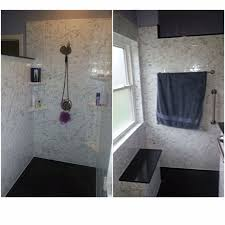 large white fiberglass tubs mixed black ceramic floor as well f rebath 12