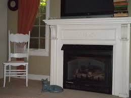 modest corner fireplace design with white wooden mantel appealing