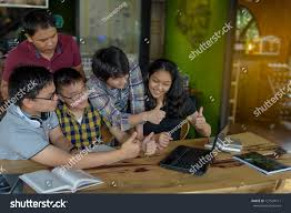 finding classmates classmates discussing brainstorming thumbing stock