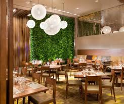 interior natural restaurant design by applying green plant wall
