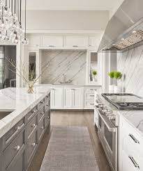 white kitchen cabinets grey island contrasting grey island white perimeter cabinetry