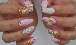 pink acrylic nails with floral ornaments metdaan