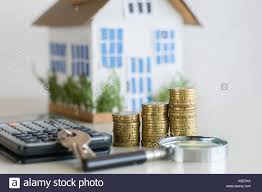 mortgage concept focused on the coins and keys real estate