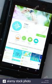 fitbit app android activity tracking app fitbit on an android tablet pc dorset stock